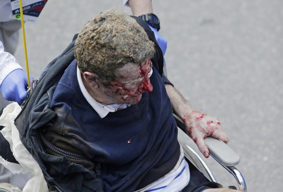 https://cdn.theatlantic.com/assets/media/img/photo/2013/04/photos-of-the-boston-marathon-bombing/b03_79465430/main_900.jpg?1420510138