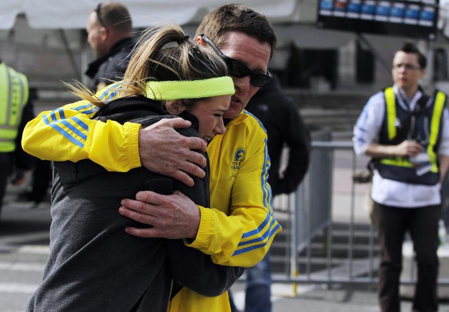 https://cdn.theatlantic.com/assets/media/img/photo/2013/04/photos-of-the-boston-marathon-bombing/b11_0RTXYMWY/main_900.jpg?1420510142