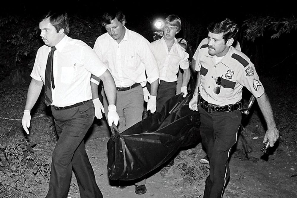Truman Simons (far Right) Helping Carry The Body Of The Teenagers Out From The Brush In Speegleville Park On July 14, 1982